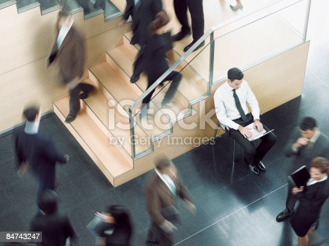 483635979 istock photo Businessman working in busy office corridor 84743247