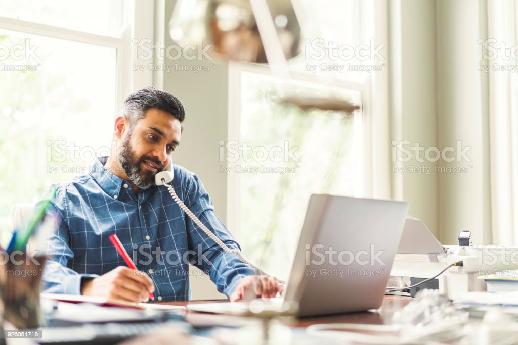 Businessman Working In Home Office Stock Photo - Download ...