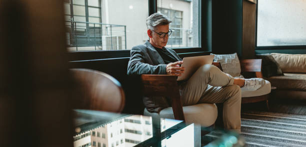 Businessman working in office lounge stock photo