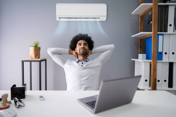 Businessman Working In Office With Air Conditioning stock photo