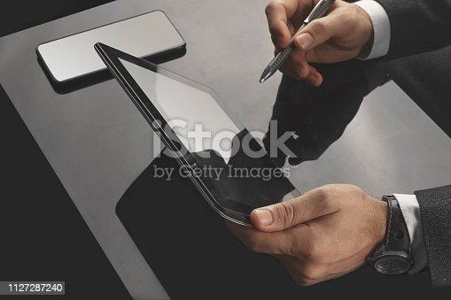 istock Businessman working in the office with communication equipments 1127287240