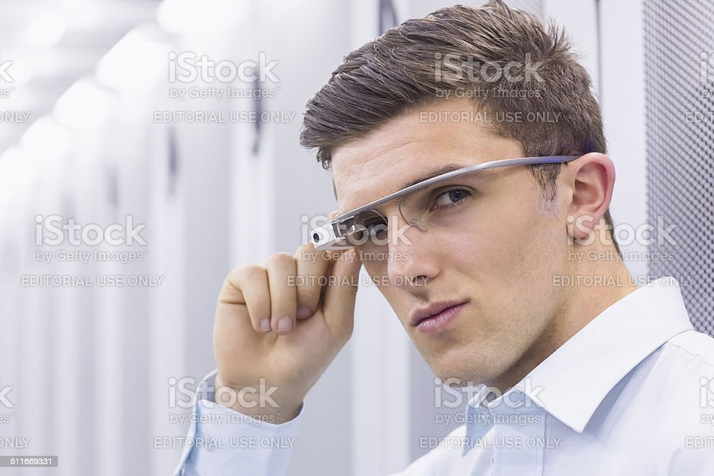 Businessman working in the server room stock photo