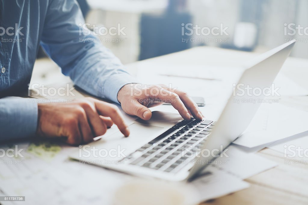 Businessman working laptop for new architectural project. Generic design notebook stock photo