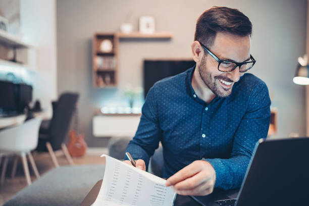 Businessman working late at home stock photo