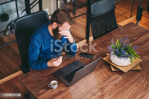 913327640 istock photo Businessman working late in the office 1253624149