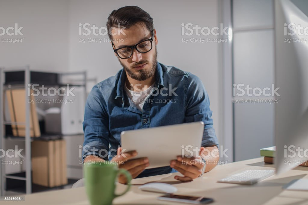 Businessman working late in the office stock photo