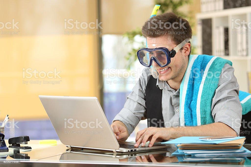 Businessman working needing vacations stock photo