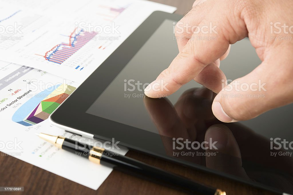 Businessman working on a digital tablet stock photo