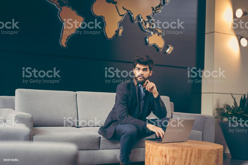 Businessman working on a laptop computer stock photo