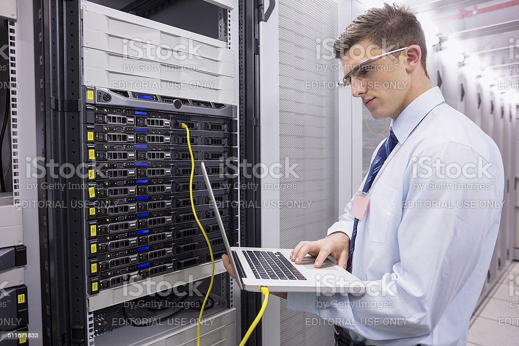 Businessman working on a server stock photo