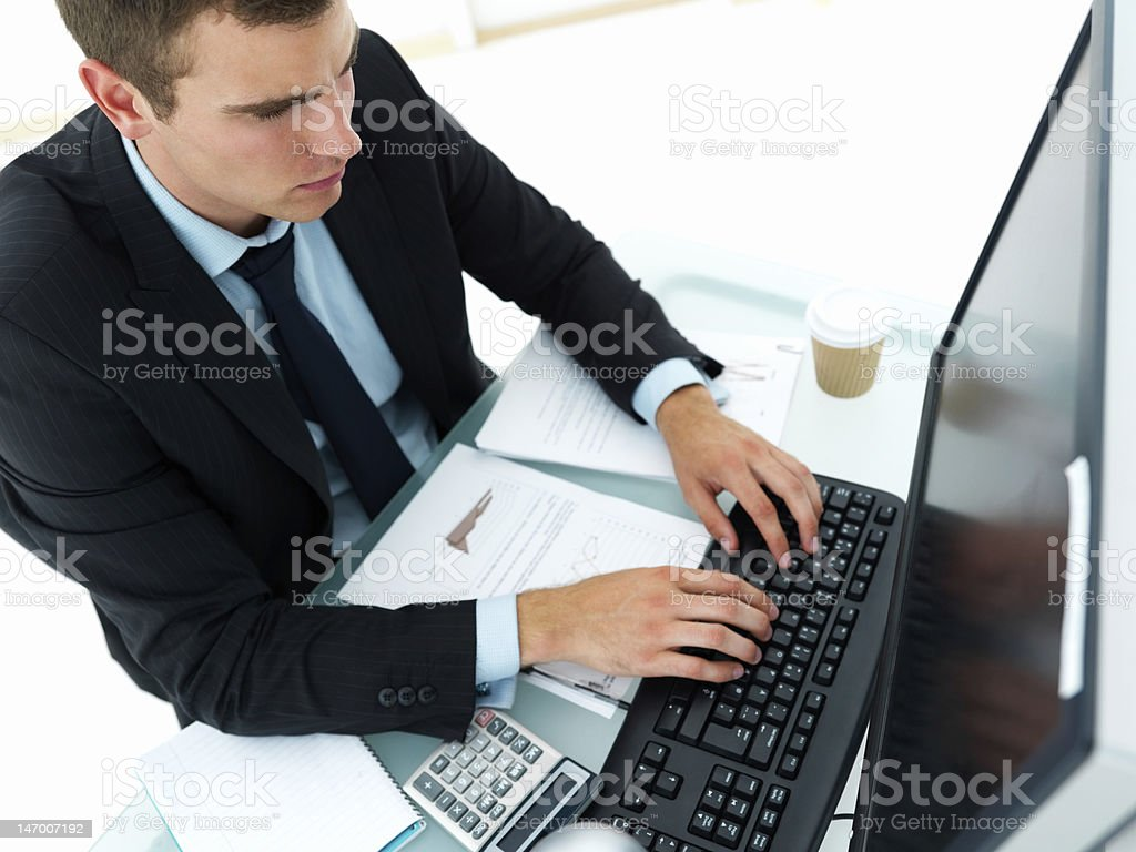 Businessman working on computer at office desk royalty-free stock photo