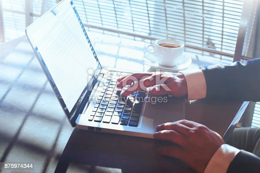 879813798istockphoto businessman working on computer, closeup of  hands 875974344