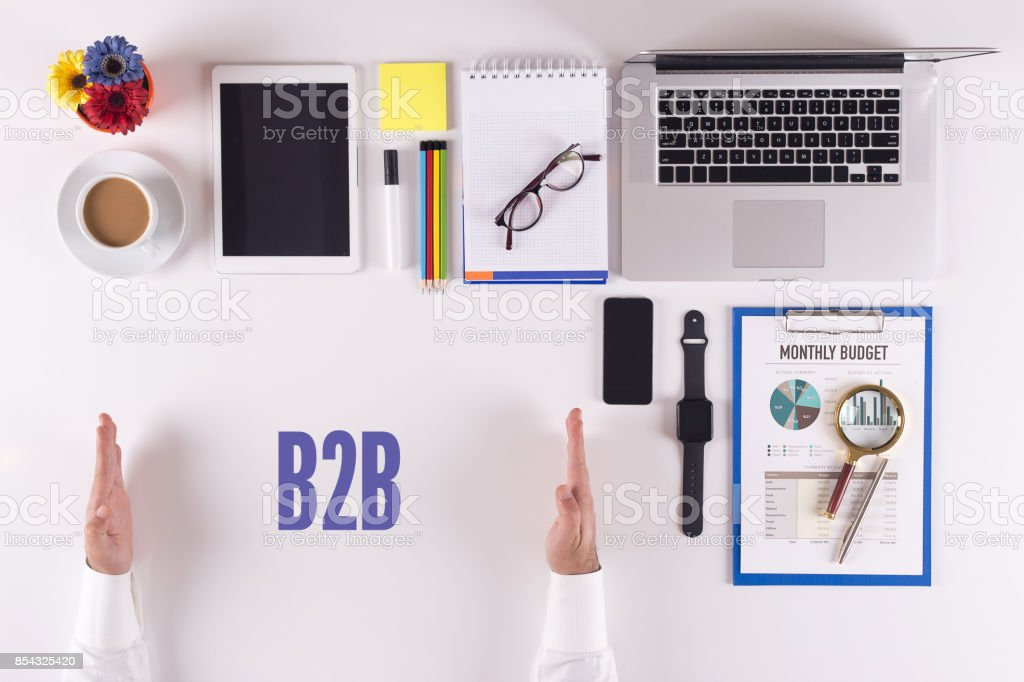 Businessman working on desk - hands showing B2C concept stock photo