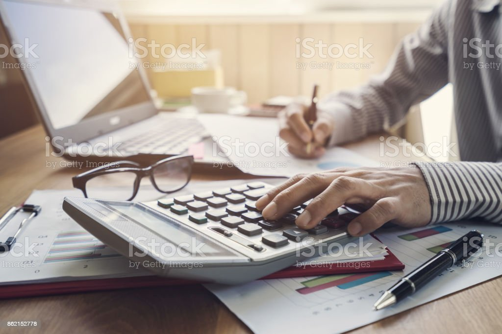 Businessman working on Desk office business financial accounting calculate stock photo