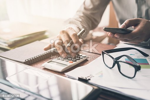 645670208istockphoto Businessman working on Desk office 645670208