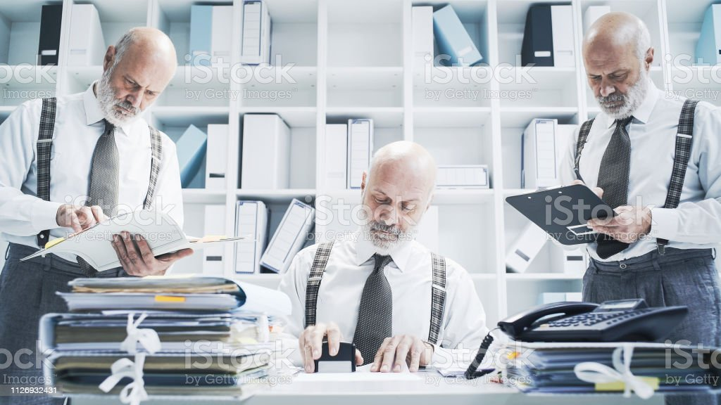 Businessman working on different tasks at the same time stock photo