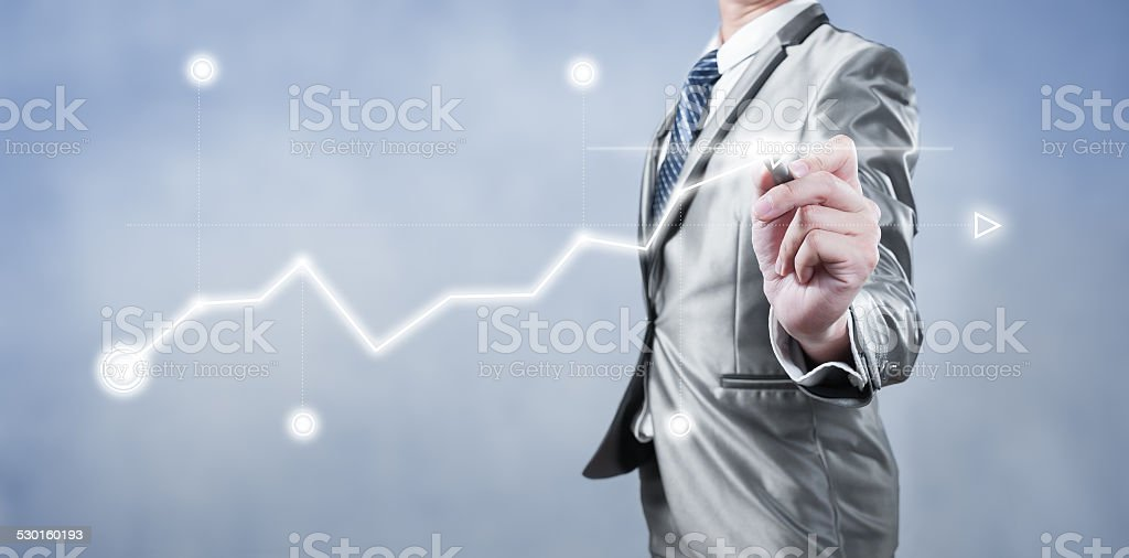 Businessman working on digital chart, business strategy concept stock photo