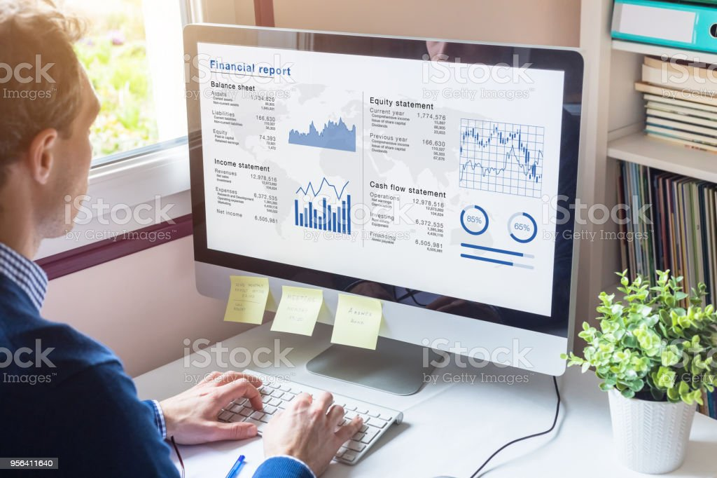 Businessman working on Financial Report of corporate operations, balance, KPI stock photo