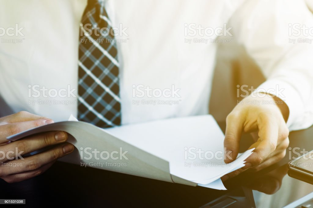 Businessman working on his laptop computer sitting in office stock photo