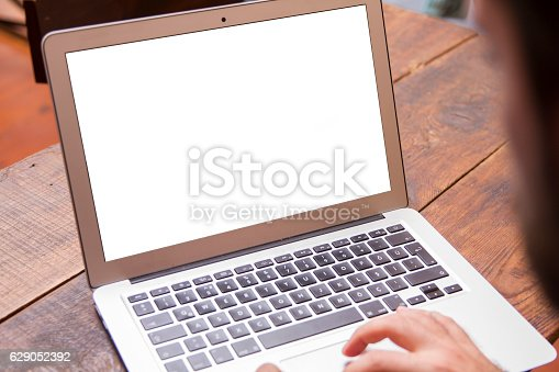 istock Businessman working on his laptop with copy space 629052392