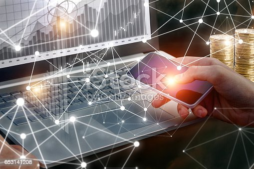istock Businessman working on laptop and phone. 653141208