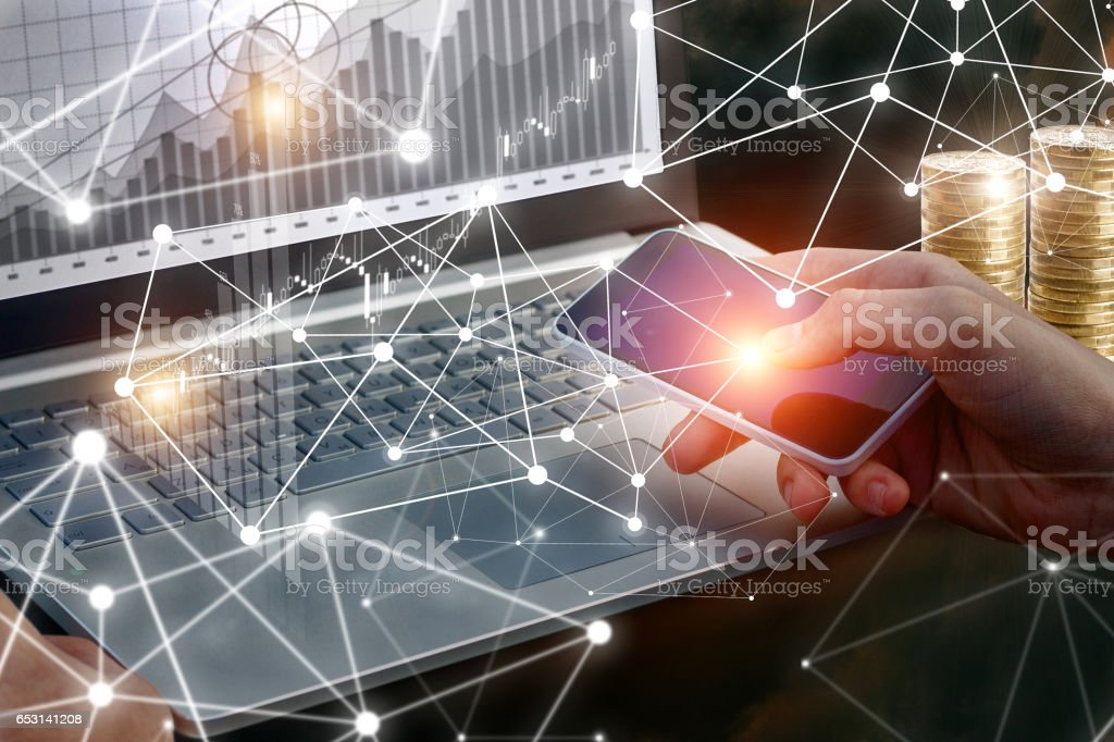 Businessman working on laptop and phone. stock photo