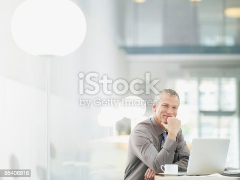 istock Businessman working on laptop in cafe 85406916