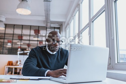 872006502 istock photo Businessman working on laptop in office 469772338