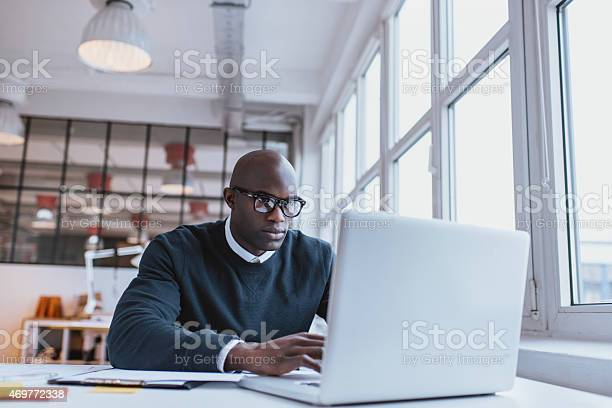 Businessman working on laptop in office picture id469772338?b=1&k=6&m=469772338&s=612x612&h=vxyokfjzjxag6ol64z0fs hewxfteh9dzpgrattp9xw=