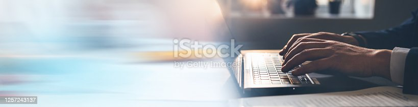 Businessman working on laptop. Panoramic business banner
