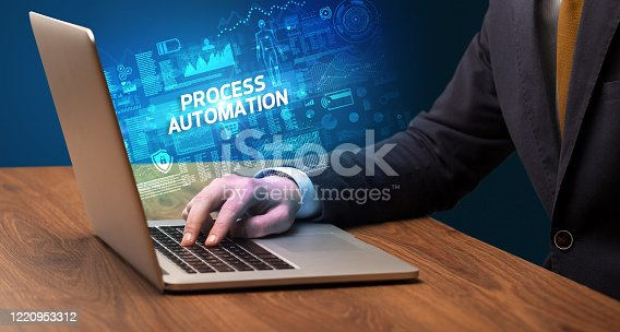 1160751010 istock photo Businessman working on laptop 1220953312
