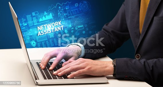 1160751010 istock photo Businessman working on laptop 1220955730