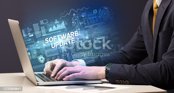 1160751010 istock photo Businessman working on laptop 1220956841
