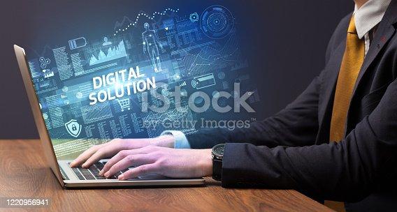 1160751010 istock photo Businessman working on laptop 1220956941