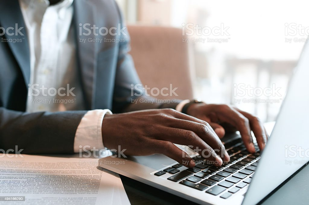 Businessman working on laptop stock photo