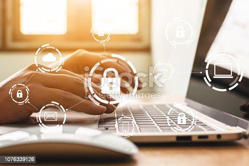istock Businessman working on laptop. Protection network security computer and safe your data concept. Digital crime by an anonymous hacker 1076339126