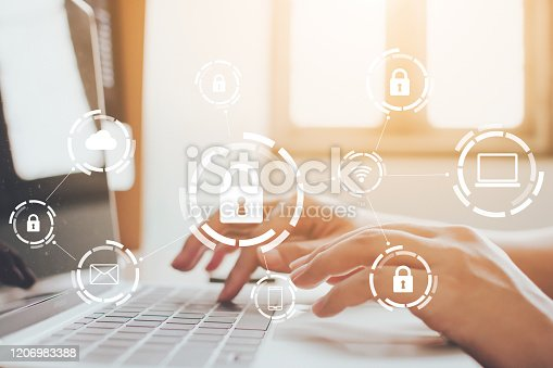 istock Businessman working on laptop. Protection network security computer and safe your data concept. Digital crime by an anonymous hacker 1206983388