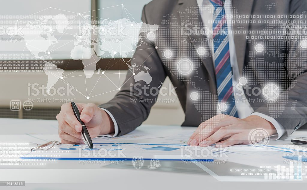Businessman working on paperwork with technology background stock photo
