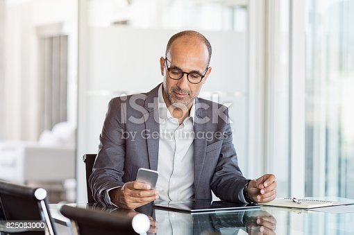 istock Businessman working on phone 825083000