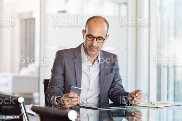Businessman Working On Phone Stock Photo - Download Image Now