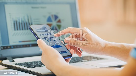 875087884 istock photo businessman working on project for analyzing company financial report balance statement with documents graphics at modern office space. Concept picture of business,economy, market,money and tax. 1224410933