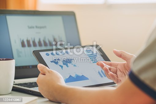 875087884 istock photo businessman working on project for analyzing company financial report balance statement with documents graphics at modern office space. Concept picture of business,economy, market,money and tax. 1224410967