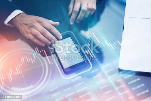 960164282 istock photo Businessman working on project using hi technology digital tablet 1148608182