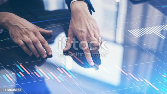 istock Businessman working on project using hi technology digital tablet 1148608184