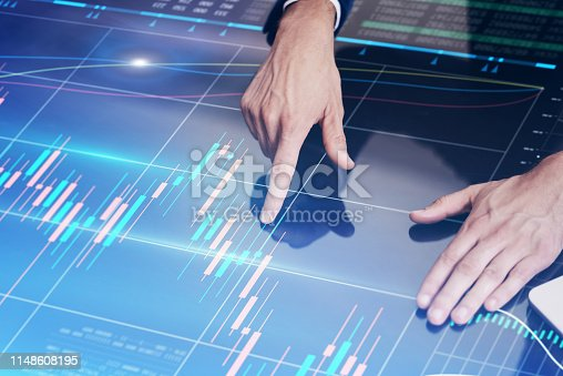 960164282istockphoto Businessman working on project using hi technology digital tablet 1148608195