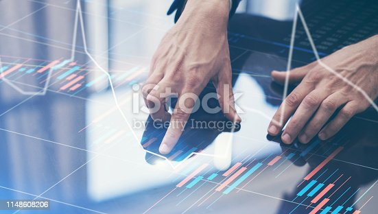 istock Businessman working on project using hi technology digital tablet 1148608206