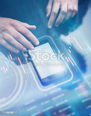 960164282 istock photo Businessman working on project using hi technology digital tablet 1148608217