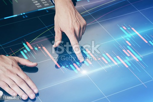 960164282 istock photo Businessman working on project using hi technology digital tablet 1148608221