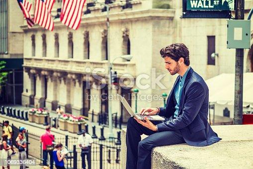 istock Businessman working on street in New York 1069336404