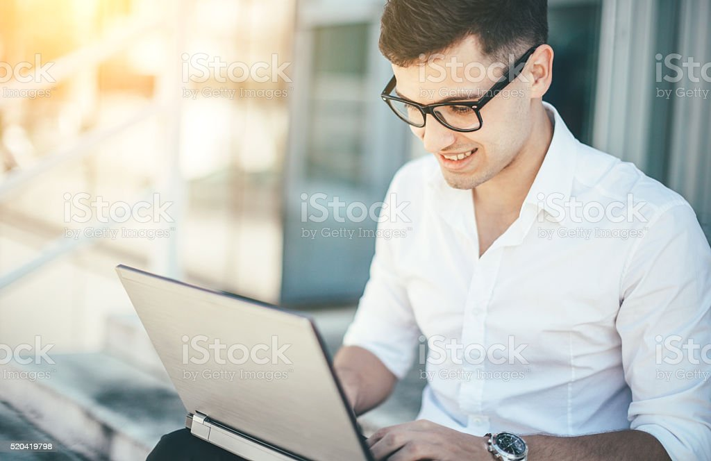 Businessman working on the laptop. stock photo